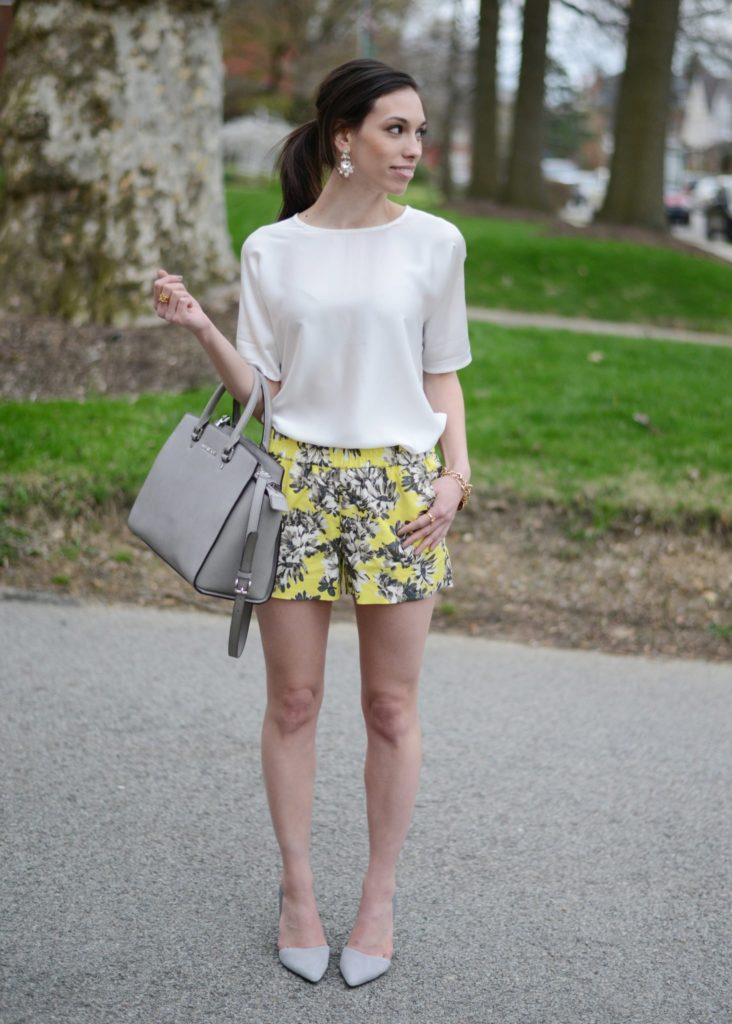 J.Crew Factory Boardwalk Pull-On Shorts | Wellesley & King | J Crew Boardwalk shorts styled by top US fashion blog, Wellesley & King: image of a woman wearing J Crew boardwalk floral shorts, Piperlime shoes, J Crew white shirt, Michael Kors bag, and Banana Republic earrings.