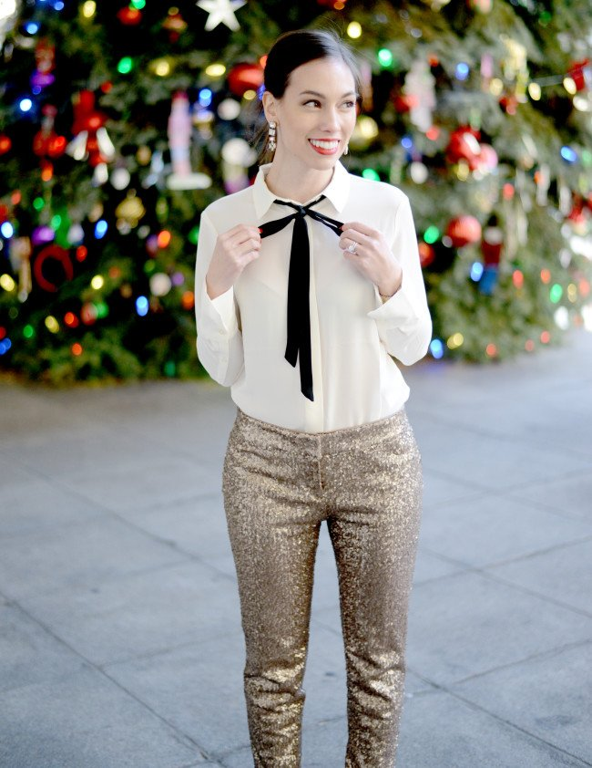 Wellesley & King | An outfit perfect for your office holiday party: sequin pants, a bow tie blouse and red lipstick. Classic and conservative. See all outfit details and more feminine classic looks on www.wellesleyandking.com
