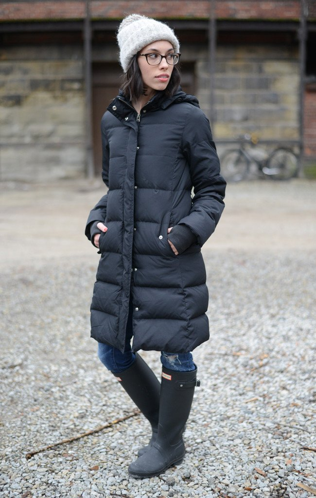 Wellesley & King | down parka, hunter boots, pom pom snow hat and distressed jeans for a casual chic winter outfit