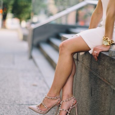 white shift dress-wellesley and king-@wellesleynking | 9 Must Have Shoes for Women featured by top Pittsburgh fashion blog, Wellesley & King: image of a woman wearing rockstud heels