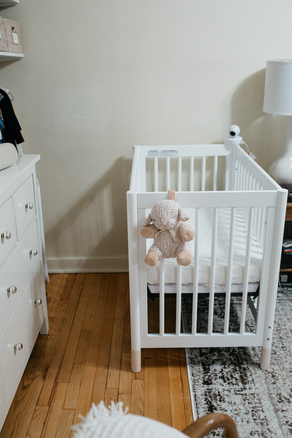 Top US lifestyle blogger, Wellesley & King, styles a tiny nursery in an apartment: small nursery ideas, small nursery organization, tiny nursery decor, tiny nursery ideas, tiny nursery organization, mini crib, convertible mini crib