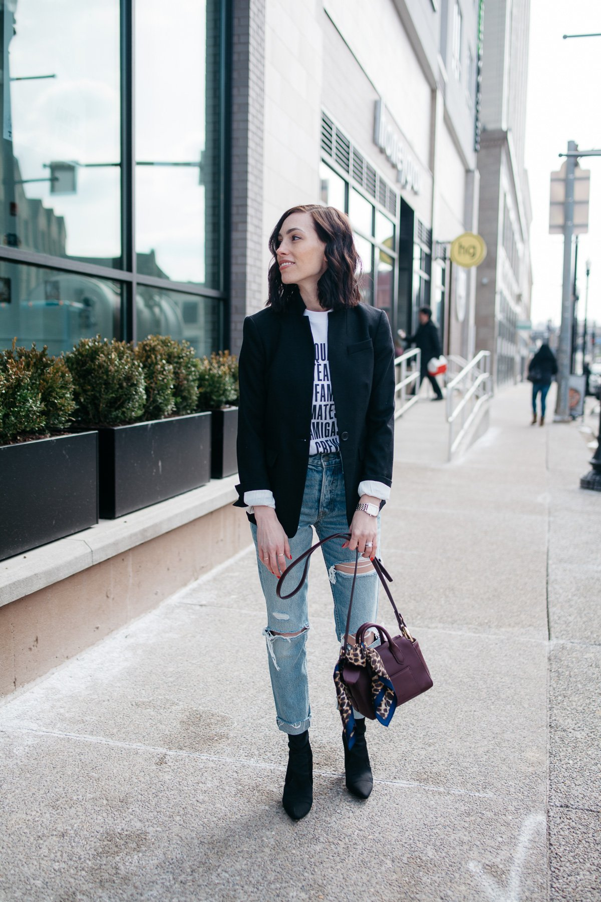 Top US fashion blogger, Wellesley & King, styles a graphic tshirt three ways: girl in tshirt, jcrew blazer, and distressed jeans
