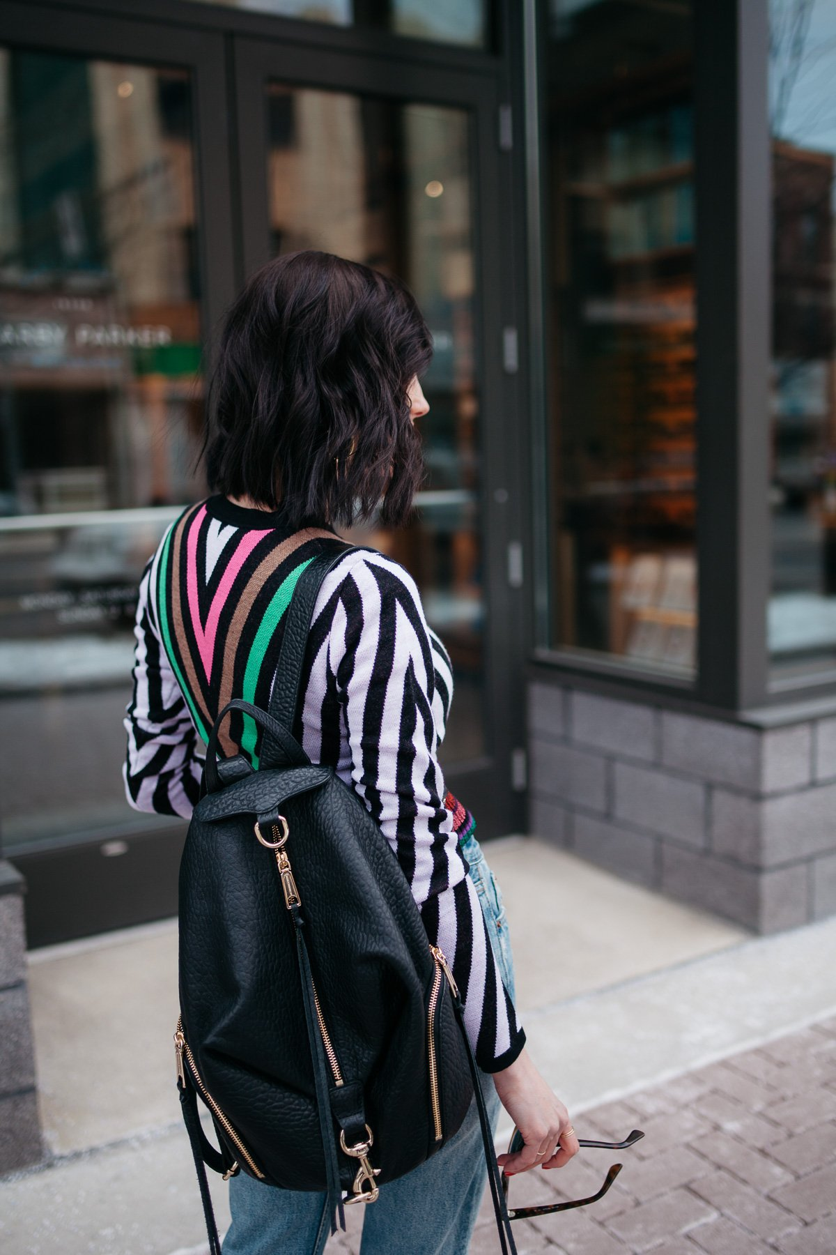 Top US fashion blogger, Wellesley & King, styles a DVF sweater three ways: girl in dvf sweater, distressed jeans, jcrew rebecca minkoff black leather backpack outfit