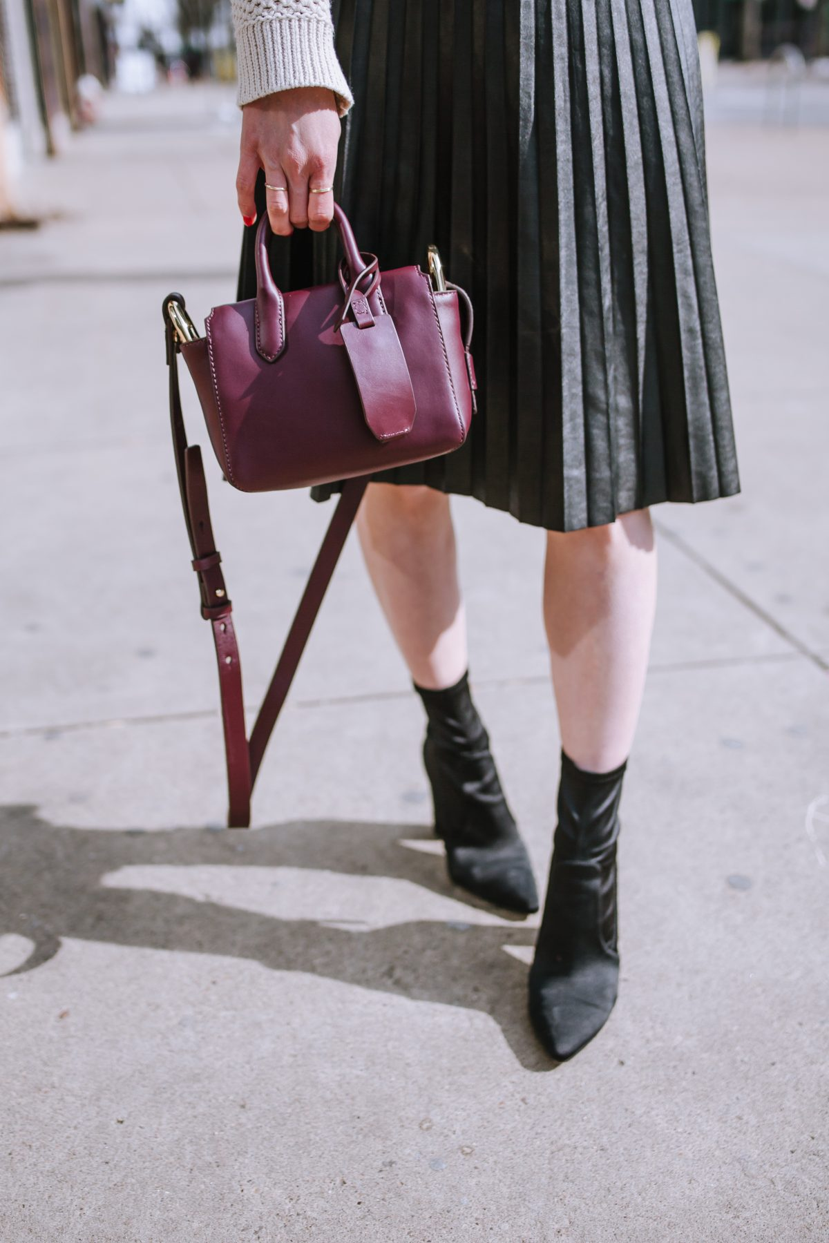 Top US lifestyle blogger, Wellesley & King, styles a shopbop oversized turtleneck outfit two ways: pleated leather midi skirt, black sock booties, leather mini bag, oversized turtleneck, distressed denim jeans, leopard scarf, petite fashion, outfits for petite bodies